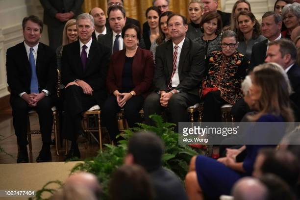 Supreme Court Justices, Brett Kavanaugh, Neil Gorsuch, Elena Kagan, Samuel Alito, Ruth Bader Ginsburg, and Chief Justice John Roberts attend a...