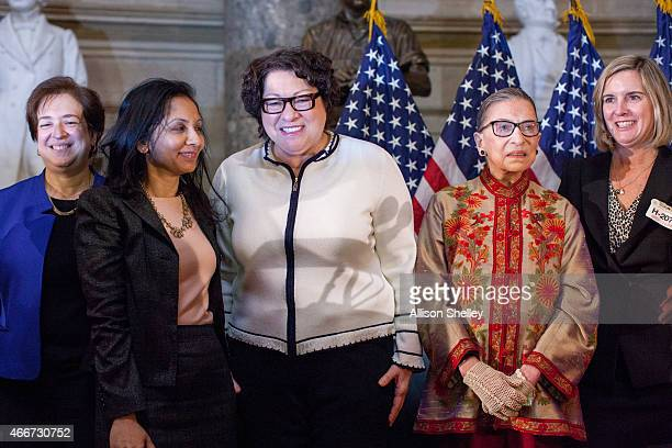 S Supreme Court justices Elena Kagan L Sonia Sotomayor third from L and Ruth Bader Ginsburg second from R pose for a photo with attendees at an...