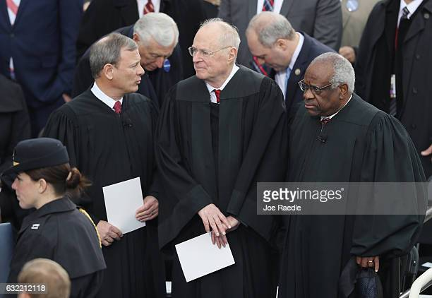 Supreme Court Justices John Roberts Anthony Kennedy and Clarence Thomas await the inauguration on the West Front of the US Capitol on January 20 2017...