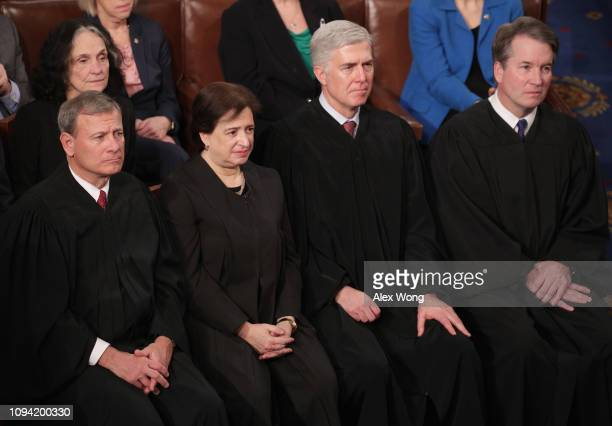 Supreme Court Justices John Roberts, Elena Kagan, Neil Gorsuch, and Brett Kavanaugh look on as President Donald Trump delivers the State of the Union...