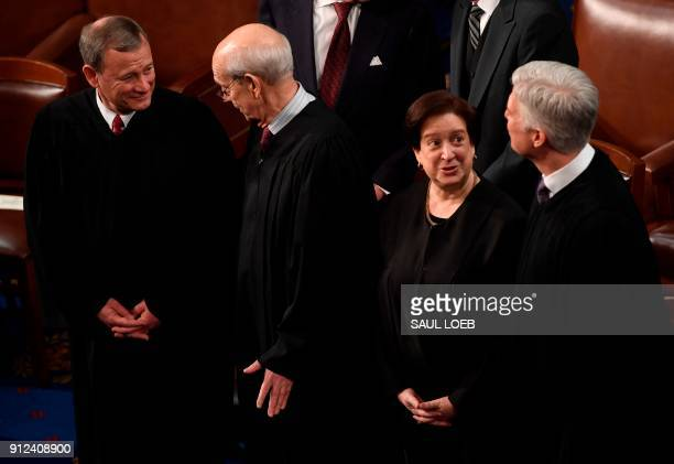 US Supreme Court justices John Roberts Stephen Breyer Elena Kagan and Neil Gorsuch speak before the State of the Union address at the US Capitol in...