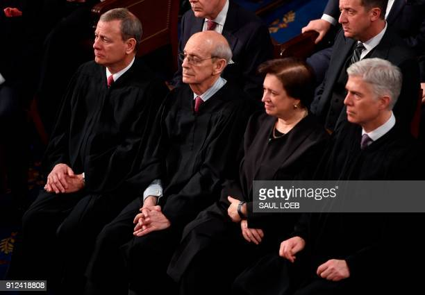 US Supreme Court justices John Roberts Stephen Breyer Elena Kagan and Neil Gorsuch look on as US President Donald Trump delivers the State of the...
