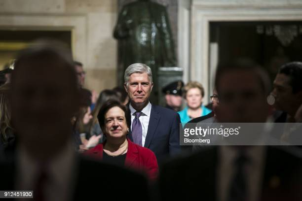 Supreme Court Justices Neil Gorsuch center right and Elena Kagan center left arrive arrive ahead of a State of the Union address to a joint session...