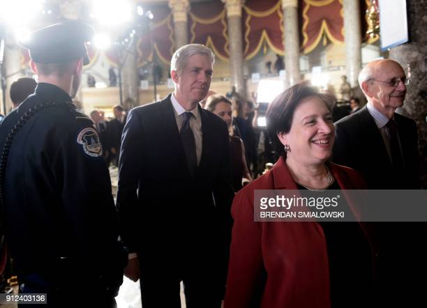 US Supreme Court justices Neil Gorsuch Elena Kagan and Stephen Breyer arrive for the State of the Union address at the US Capitol in Washington DC on...