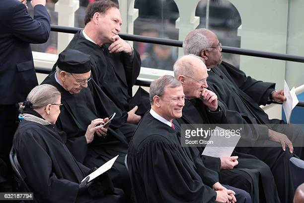 Supreme Court Justices Ruth Bader Ginsburg Stephen Breyerm Samuel Alito John Roberts Anthony Kennedy and Clarence Thomas sit on the West Front of the...