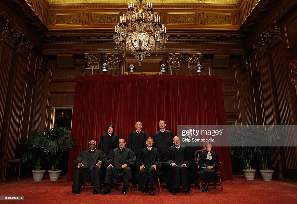 U.S. Supreme Court members (first row L-R) Associate Justice Clarence Thomas, Associate Justice Antonin Scalia, Chief Justice John Roberts, Associate Justice Anthony Kennedy, Associate Justice Ruth Bader Ginsburg, (back row L-R) Associate Justice Sonia Sotomayor, Associate Justice Stephen Breyer, Associate Justice Samuel Alito and Associate Justice Elena Kagan pose for photographs in the East Conference Room at the Supreme Court building October 8, 2010 in Washington, DC. This is the first time in history that three women are simultaneously serving on the court.