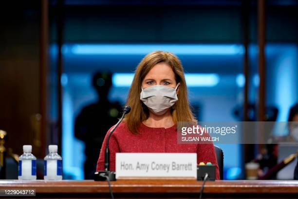 Supreme Court nominee Amy Coney Barrett listens during a confirmation hearing before the Senate Judiciary Committee, on Capitol Hill on October 13,...