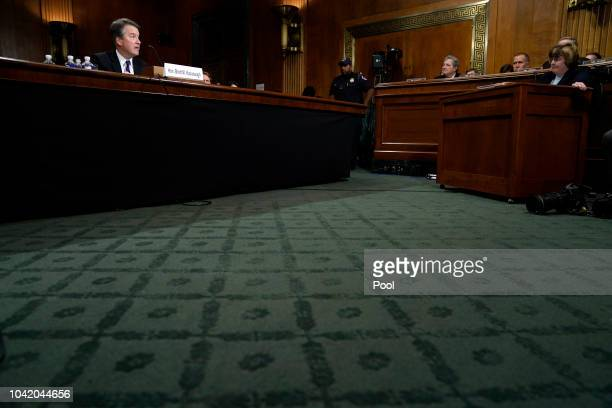 Supreme Court nominee Brett Kavanaugh answers questions from Phoenix prosecutor Rachel Mitchell as he testifies before the Senate Judiciary Committee...