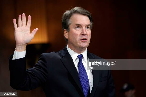 Supreme Court nominee Brett Kavanaugh is sworn in to testify before the Senate Judiciary Committee on Capitol Hill on September 27 2018 in Washington...