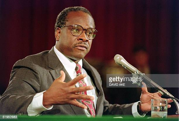 Supreme Court nominee Clarence Thomas gestures, 10 September 1991, during confirmation hearings before the US Senate Judiciary Committee, in...
