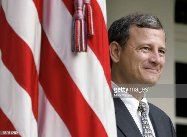 S Supreme Court nominee John G Roberts Jr smiles after having breakfast with US President George W Bush at the White House July 20 2005 in Washington...