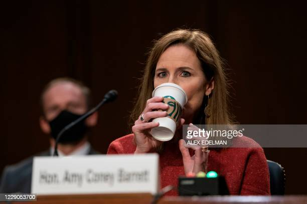 Supreme Court nominee Judge Amy Coney Barrett drink coffee during her confirmation hearing before the Senate Judiciary Committee confirmation hearing...