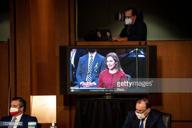 Supreme Court nominee Judge Amy Coney Barrett is seen on a tv speaking during the Senate Judiciary Committee on the second day of Amy Coney Barrett's...