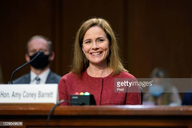 Supreme Court nominee Judge Amy Coney Barrett listens on the second day of her Supreme Court confirmation hearing before the Senate Judiciary...
