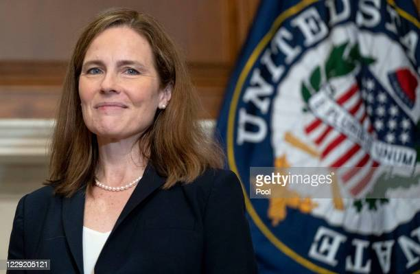 Supreme Court nominee Judge Amy Coney Barrett poses for a photo with junior United States Senator James Lankford on Capitol Hill on October 21, 2020...