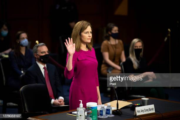 Supreme Court nominee Judge Amy Coney Barrett swears in before the Senate Judiciary Committee on the first day of her Supreme Court confirmation...