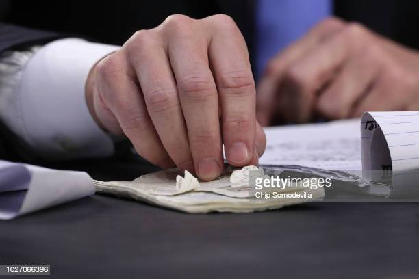 Supreme Court nominee Judge Brett Kavanaugh fingers a wellworn pocketsized copy of the US Constitution as he testifies before the Senate Judiciary...