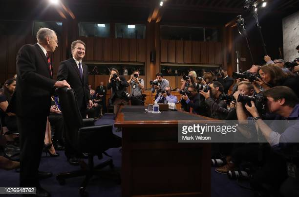 Supreme Court nominee Judge Brett Kavanaugh is greeted by committee chairman Sen. Chuck Grassley as Kavanaugh arrives for testimony before the Senate...