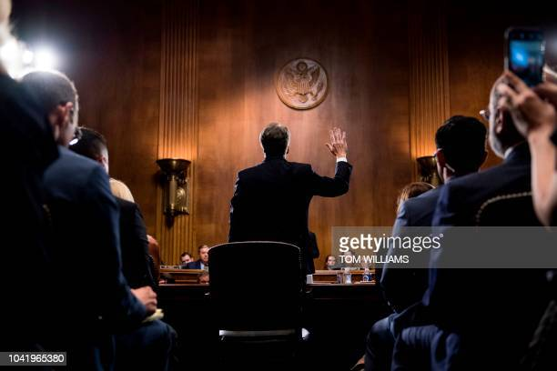 Supreme Court nominee Judge Brett Kavanaugh is sworn in before testifying at the Senate Judiciary Committee on Capitol Hill in Washington DC on...