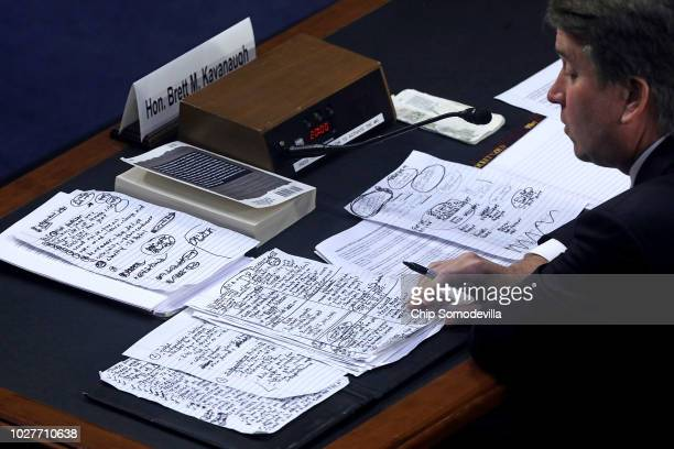 Supreme Court nominee Judge Brett Kavanaugh looks over his handwritten notes while testifying before the Senate Judiciary Committee on the third day...