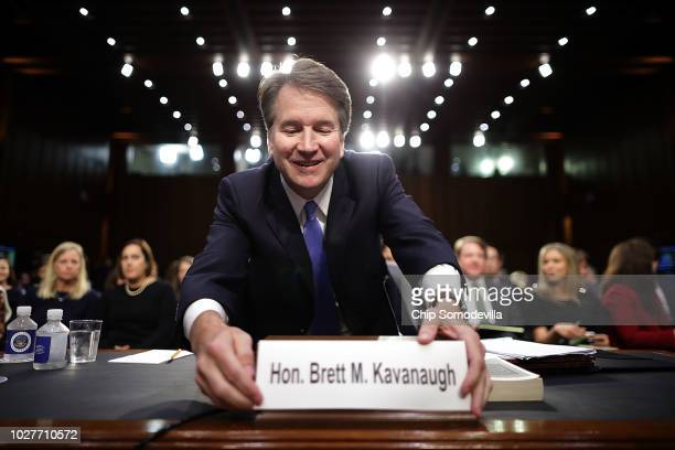 Supreme Court nominee Judge Brett Kavanaugh organizes his desk before testifying to the Senate Judiciary Committee on the third day of his Supreme...