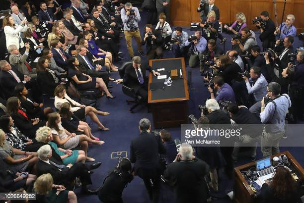 Supreme Court nominee Judge Brett Kavanaugh points to his family as he arrives for testimony before the Senate Judiciary Committee during his Supreme...