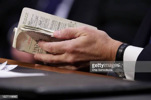 Supreme Court nominee Judge Brett Kavanaugh thumbs through a wellworn pocketsized copy of the US Constitution as he testifies before the Senate...
