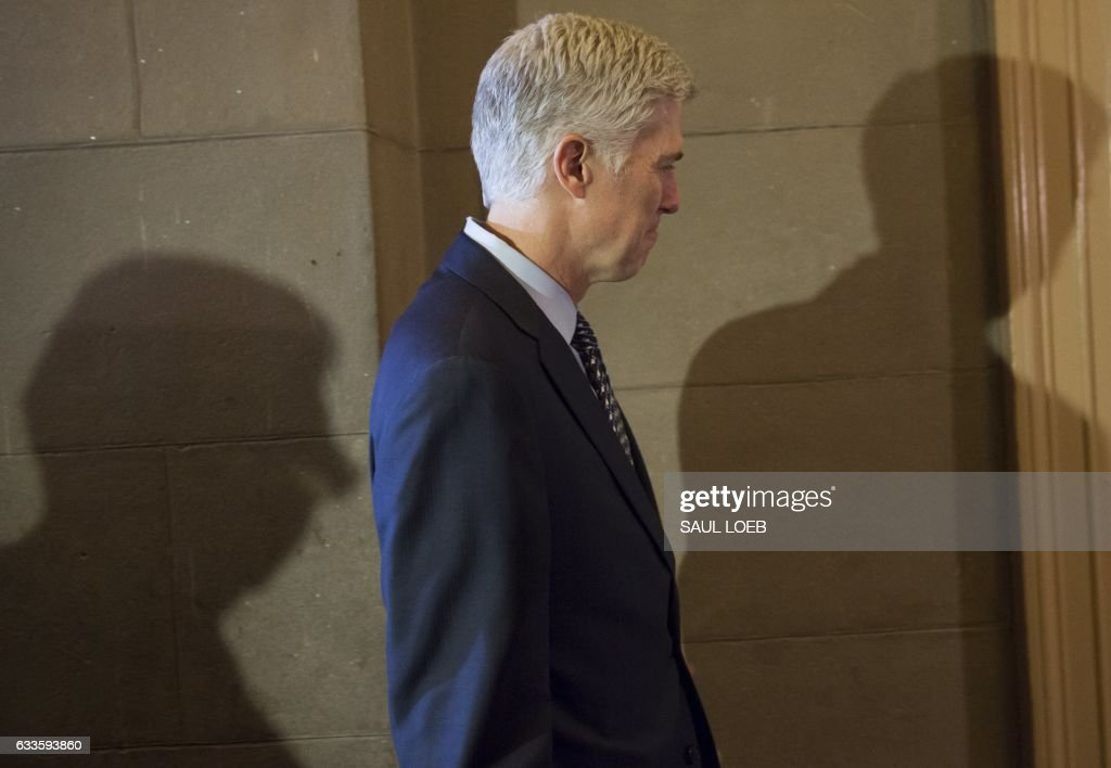 Supreme Court nominee Judge Neil Gorsuch arrives for a meeting at the US Capitol in Washington, DC, February 2, 2017. / AFP / SAUL
