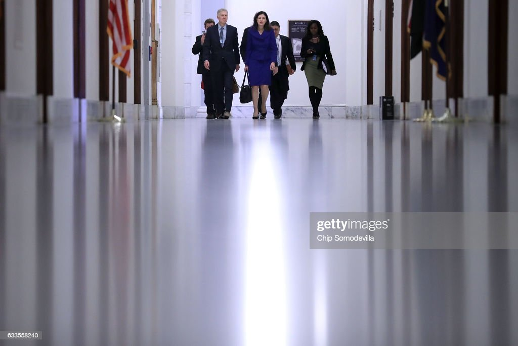 Supreme Court nominee Judge Neil Gorsuch (L) is accompanied by former US senator Kelly Ayotte of New Hampshire (C) as they arrive at the Russell Senate Office Building for a meeting with Sen. Shelley Moore Capito (R-WV) on Capitol Hill February 2, 2017 in Washington, DC. President Donald Trump nominated Judge Gorsuch to the Supreme Court to fill the seat that had left vacant with the death of Associate Justice Antonin Scalia in February 2016.