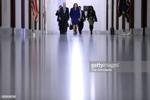 Supreme Court nominee Judge Neil Gorsuch is accompanied by former US senator Kelly Ayotte of New Hampshire as they arrive at the Russell Senate...