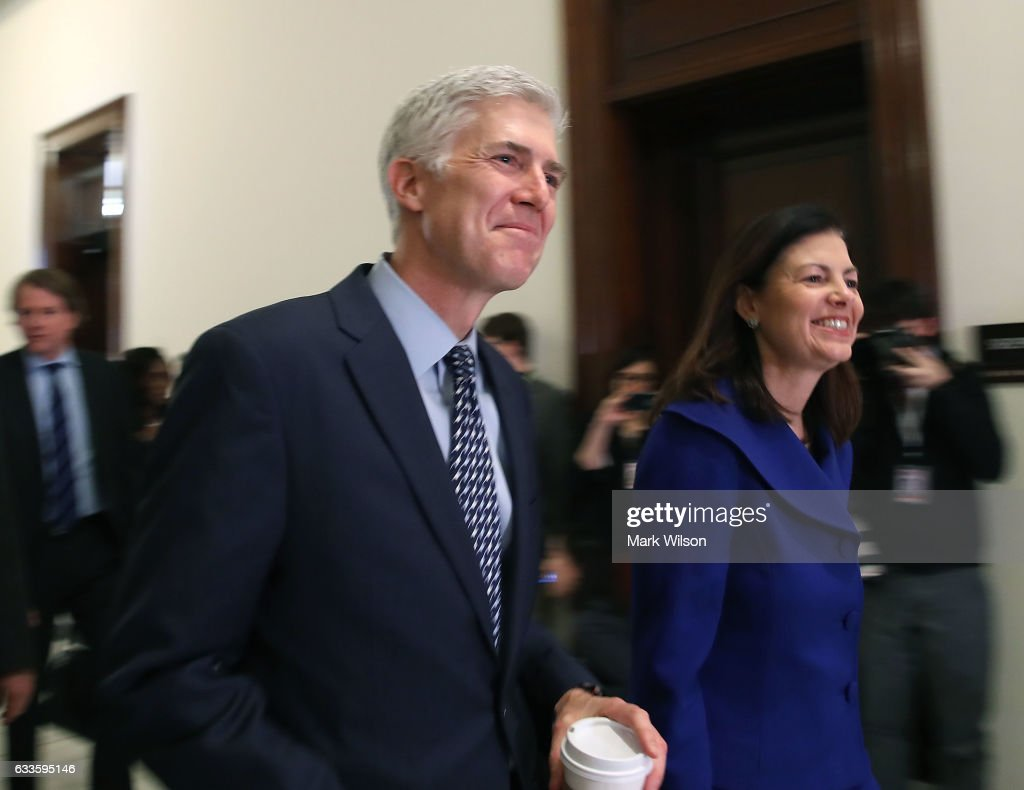 Supreme Court nominee Judge Neil Gorsuch is accompanied by former U.S. Senator Kelly Ayotte (R-NH), while making a visit to Sen. Lindsey Graham's (R-SC) office on Capitol Hill February 2, 2017 in Washington, DC. President Donald Trump nominated Judge Gorsuch to the Supreme Court to fill the seat that had left vacant with the death of Associate Justice Antonin Scalia in February 2016.