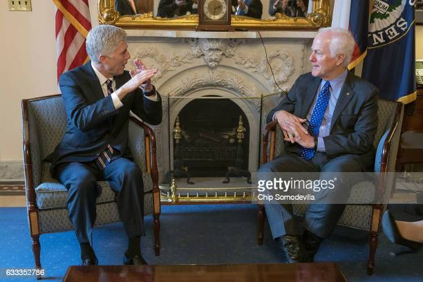 Supreme Court nominee Judge Neil Gorsuch meets with Senate Majority Whip John Cornyn in his office in the US Capitol February 1 2017 in Washington DC...