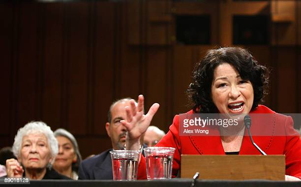 Supreme Court nominee Judge Sonia Sotomayor answers questions from Sen Patrick Leahy as her mother Celina Sotomayor looks on during the second day of...