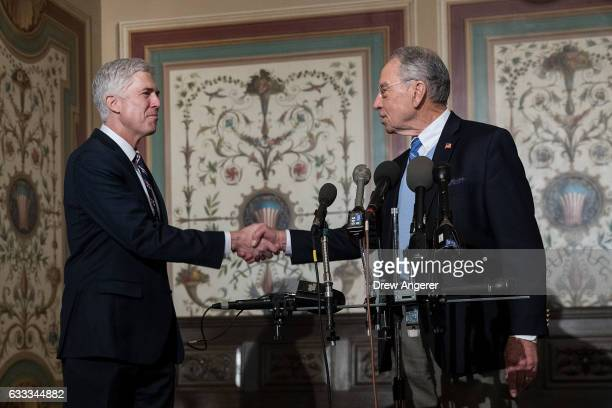 Supreme Court nominee Neil Gorsuch and Senate Judiciary chairman Sen Chuck Grassley shake hands after Grassley spoke to reporters before their...