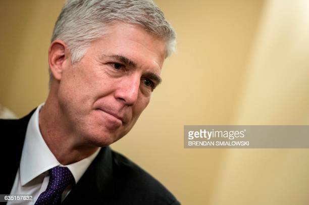 US Supreme Court nominee Neil Gorsuch waits for a meeting on Capitol Hill February 13 2017 in Washington DC / AFP / Brendan Smialowski