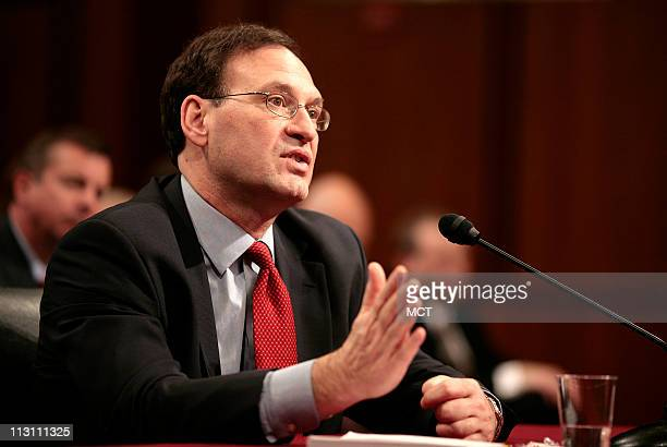 Supreme Court nominee Samuel Alito walks out during a committee break on the second day of his Senate judiciary committee confirmation hearings on...