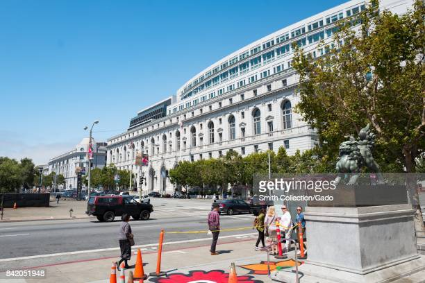 Supreme Court of California in the Civic Center neighborhood of San Francisco California with people walking past and Flower Power designs painted on...