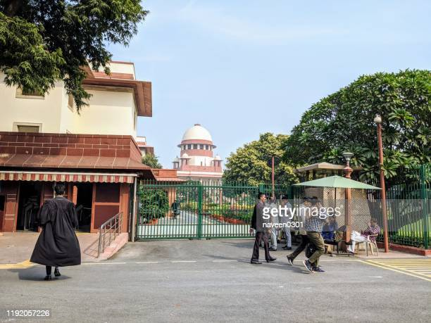 supreme court of india building in new delhi, india - india politics stock pictures, royalty-free photos & images