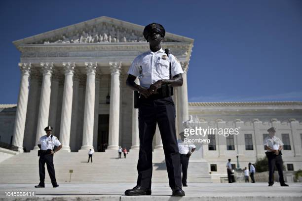 US Supreme Court police officers stand outside of the court during a demonstration in Washington DC US on Thursday Oct 4 2018 Senate Republicans...