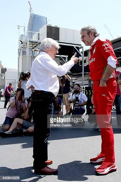 F1 supremo Bernie Ecclestone and Ferrari Team Principal Mautrizio Arrivabene talk in the Paddock during previews ahead of the European Formula One...
