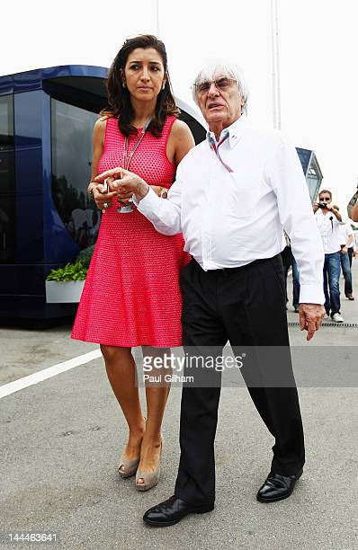 F1 supremo Bernie Ecclestone and his fiancee Fabiana Flosi are seen in the paddock before the Spanish Formula One Grand Prix at the Circuit de...