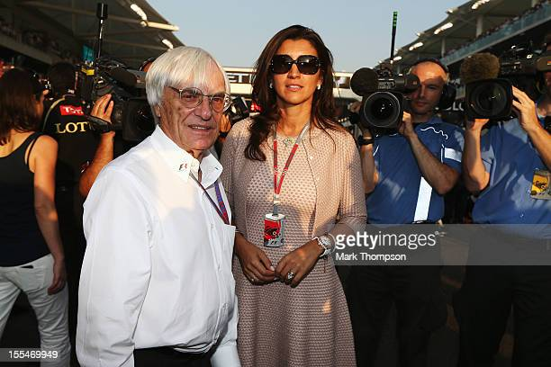Supremo Bernie Ecclestone and his wife Fabiana Flosi are seen on the grid before the Abu Dhabi Formula One Grand Prix at the Yas Marina Circuit on...
