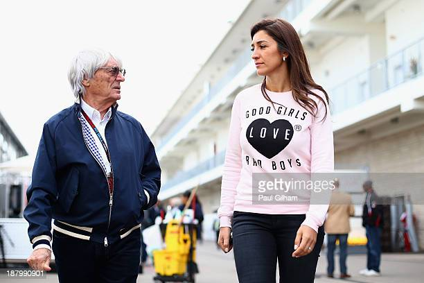 Supremo Bernie Ecclestone and his wife Fabiana Flosi arrive in the paddock during previews to the United States Formula One Grand Prix at Circuit of...