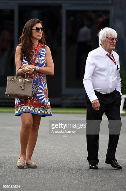 F1 supremo Bernie Ecclestone and his wife Fabiana Flosi walk on the paddock area during Formula One Grand Prix of Italy at Autodromo di Monza in...