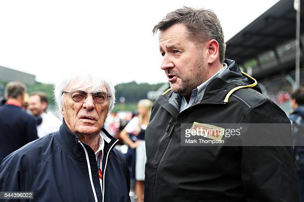 F1 supremo Bernie Ecclestone and Paul Hembery of Pirelli talk on the grid before the Formula One Grand Prix of Austria at Red Bull Ring on July 3...