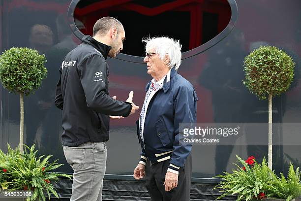 F1 supremo Bernie Ecclestone and Renault Sport Managing Director Cyril Abiteboul talk in the Paddock during final practice for the Formula One Grand...