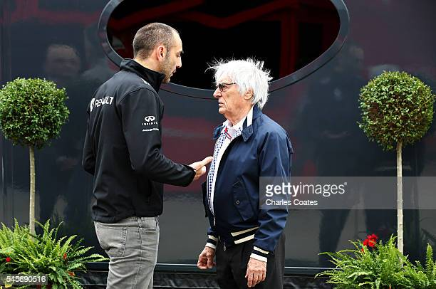F1 supremo Bernie Ecclestone and Renault Sport Managing Director Cyril Abiteboul talk in the Paddock during qualifying for the Formula One Grand Prix...