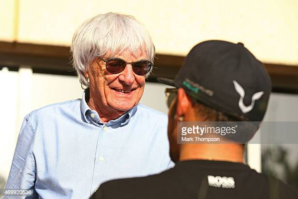 Supremo Bernie Ecclestone chats with Lewis Hamilton of Great Britain and Mercedes GP during previews to the Bahrain Formula One Grand Prix at Bahrain...