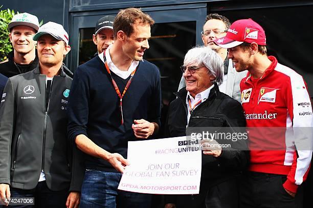 Supremo Bernie Ecclestone flanked by Toyota sportscar driver Alex Wurz Sebastian Vettel of Germany and Ferrari and drivers from the F1 grid promote...