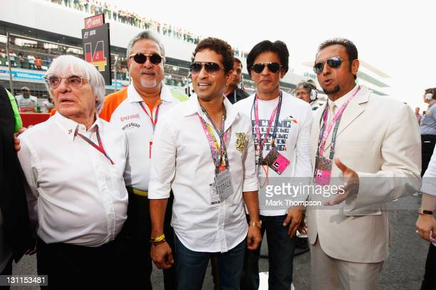 F1 supremo Bernie Ecclestone Force India Chairman Vijay Mallya cricketer Sachin Tendulkar and Bollywood actors Shahrukh Khan and Gulshan Grover are...